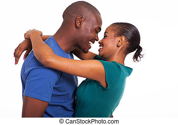 cheerful young african couple hugging isolated on white