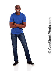 cheerful young african american man with folded arms on...
