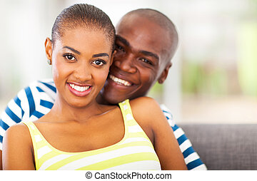 smiling young african couple in love