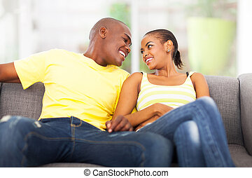 young african american couple relaxing on the couch