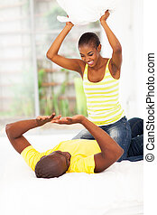 young african couple pillow fight - playful young african...