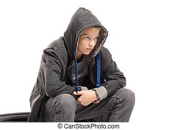Depressed teenage boy in a jacket. Isolated on white...