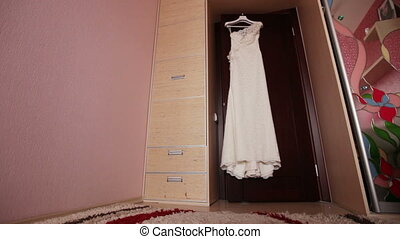 Luxury Wedding Dress - Hanging on the door of an expensive...
