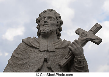 Statue of saint with cross in hands