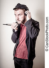 hipster stylish fashion blonde man with headphones