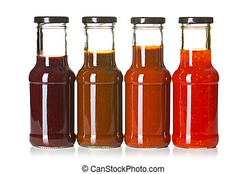 various barbecue sauces in glass bottles - the various...