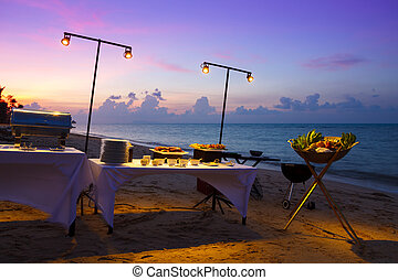 Beach restaurant at sunset