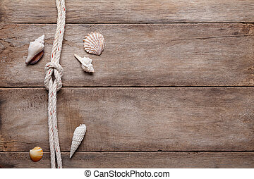 Weathered wooden table background with rope reef knot and...