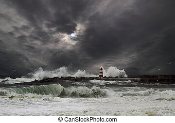 Storm waves over beacon of the harbor of Povoa do Varzim,...