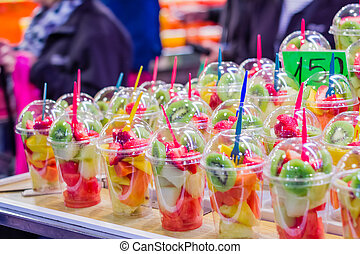 Closeup of set packed slice of fresh fruits in the famous La...