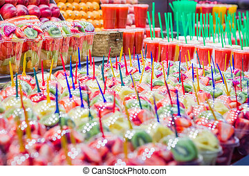 Closeup of set packed slice of fresh fruits and juices in...
