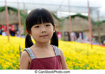 Child in flower garden