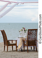 dinner setting on the beach - Outdoor restaurant tables,...
