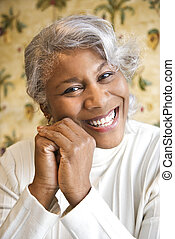 Smiling woman - Portrait of mature African American woman...