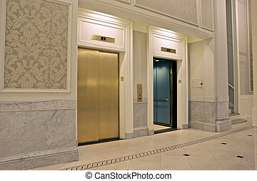 two elevators - looking at twin elevators on first floor,...