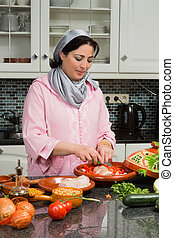 Modern kitchen traditional food - Moroccan immigrant woman...