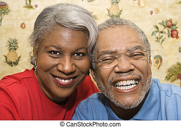 Mature couple smiling.