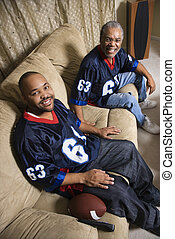 Father and adult son. - Portrait of an African-American...