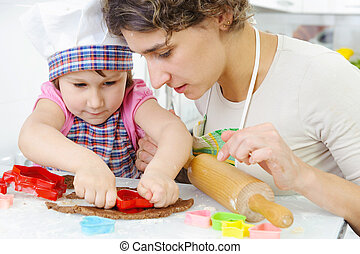 Mother with daughter making cookies