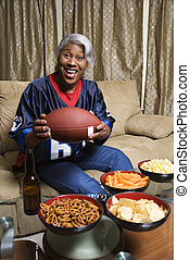 Woman football fan. - Portrait of smiling Middle-aged...
