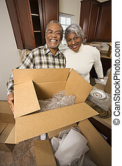 Mature couple moving - Portrait of middle-aged...