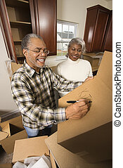 Mature couple relocating. - Middle-aged African-American...
