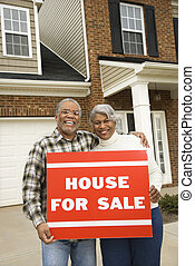 Couple selling house - Portrait of middle-aged...