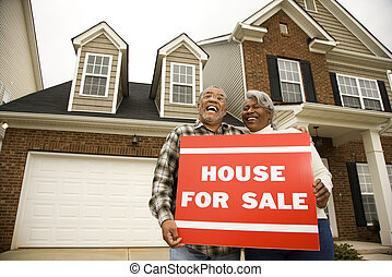 Couple buying house. - Portrait of middle-aged...