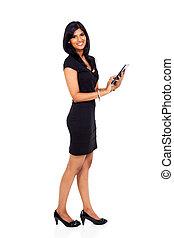 modern businesswoman using tablet computer - modern indian...