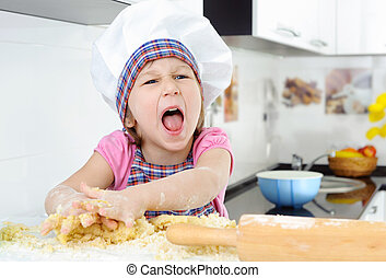 Little angry baker screaming in the kitchen