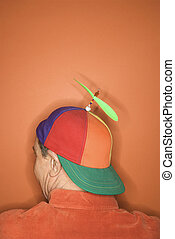 Man wearing propeller hat - Back view of middle-aged...