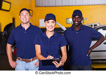 auto repair shop workers - group of happy workers in auto...
