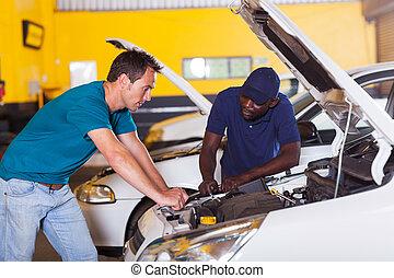 man sending his car for repair in garage