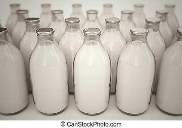 Milk bottles. - Front shot of old-fashioned glass bottles...