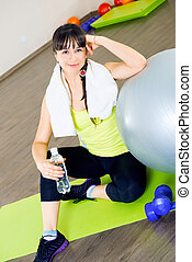 Fitness woman relax with water bottle