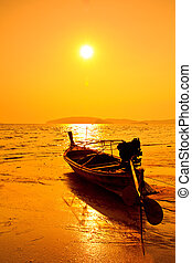 fishing boats at sea in sunset Krabi Province Thailand