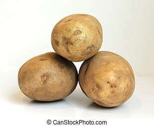 Russet Potatoes - Three raw russet potatoes stacked