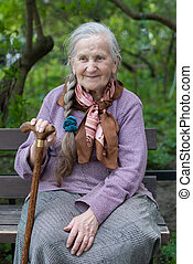 old grandmother with a long braid in the summer in the...