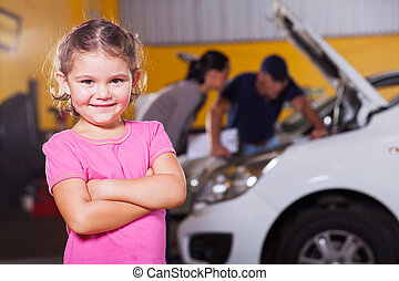 cute little girl waiting for mother in garage