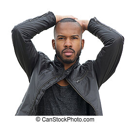 Male fashion model posing in black leather jacket - Portrait...