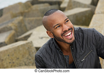 Portrait of a handsome black man smiling outdoors