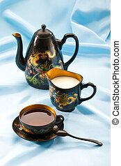 tea-drinking - Teapot and cup filled with black tea
