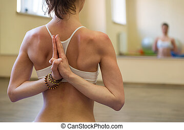 Beautiful young woman doing yoga exercise - Meditating
