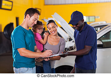 family man signing invoice - happy family man signing...