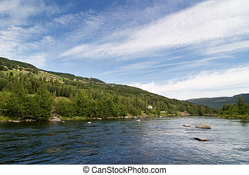 Norwegian Mountain Landscape - A landscape view of a river...