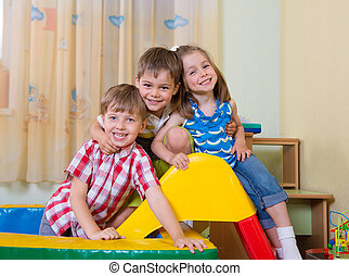 Happy children having fun at home - Happy excited children...