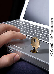 Computer Security - A key locking a laptop computer