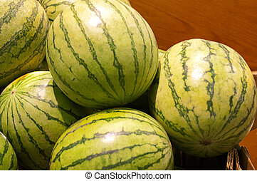 Small Sweet Watermelons - Green small sweet watermelons on...