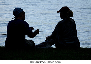 Silhouette of Two People Fishing - Silhouetted of two people...