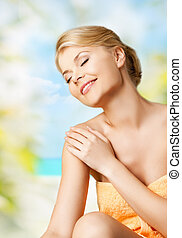 woman in spa - picture of happy woman sitting in spa